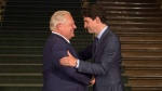 Ontario Premier Doug Ford greets Canadian Prime Minister Justin Trudeau at the Ontario Legislature, in Toronto on Thursday, July 5, 2018. THE CANADIAN PRESS/Chris Young