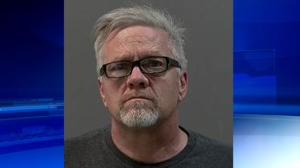 Ambulance driver charged with