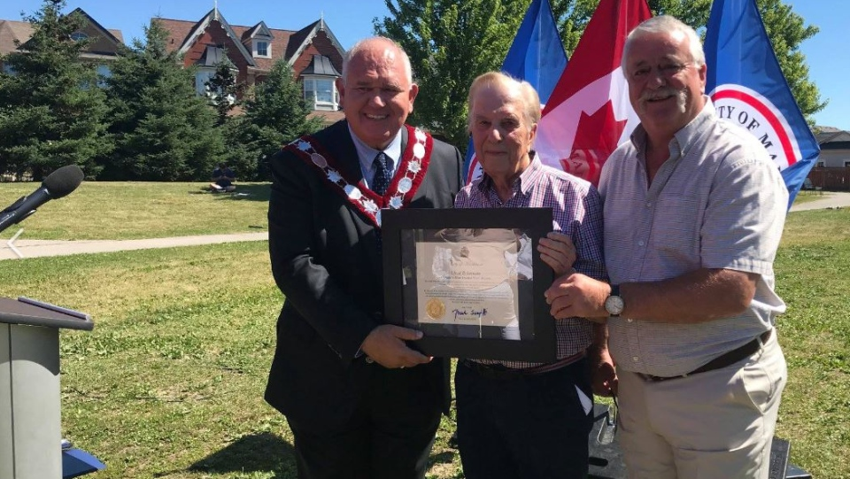 Lloyd Robertson (centre) attends the opening of a park named for him in Markham, Ont., on Saturday, July 7, 2018.