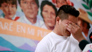 FILE - In this June 25, 2018 file photo, Christian, from Honduras, recounts his separation from his child at the border during a news conference at the Annunciation House,in El Paso, Texas. (AP Photo/Matt York, File)