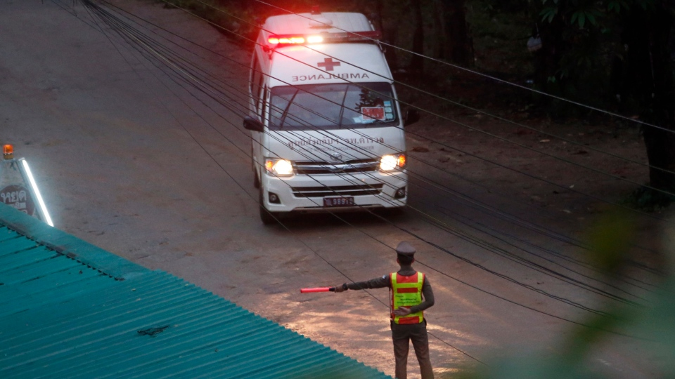 One of two ambulances leave the cave in northern Thailand hours after operation began to rescue the trapped youth soccer players and their coach, in Mae Sai, Chiang Rai province, in northern Thailand, Sunday, July 8, 2018. (AP Photo/Sakchai Lalit)