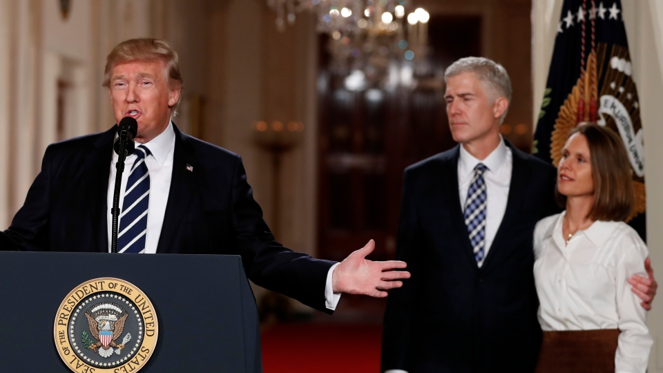 In this Jan. 31, 2017, file photo, U.S. President Donald Trump speaks in the East Room of the White House in Washington, to announce Judge Neil Gorsuch, standing with his wife Louise, as his nominee for the Supreme Court. (AP Photo/Carolyn Kaster, File)