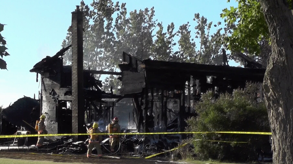 Firefighters battle blaze at a century old farmhouse on Yelverton Road, east of Port Perry on Saturday, July 7, 2018.