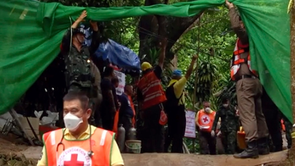 In this grab taken from video provide by Chiang Rai Public Relations Office, emergency workers carry a stretcher with one of the rescued boys to be transported by ambulance to a hospital, in Mae Sai, in the district of Chiang Rai, Thailand, Sunday, July 8, 2018. (Chiang Rai Public Relations Office via AP)