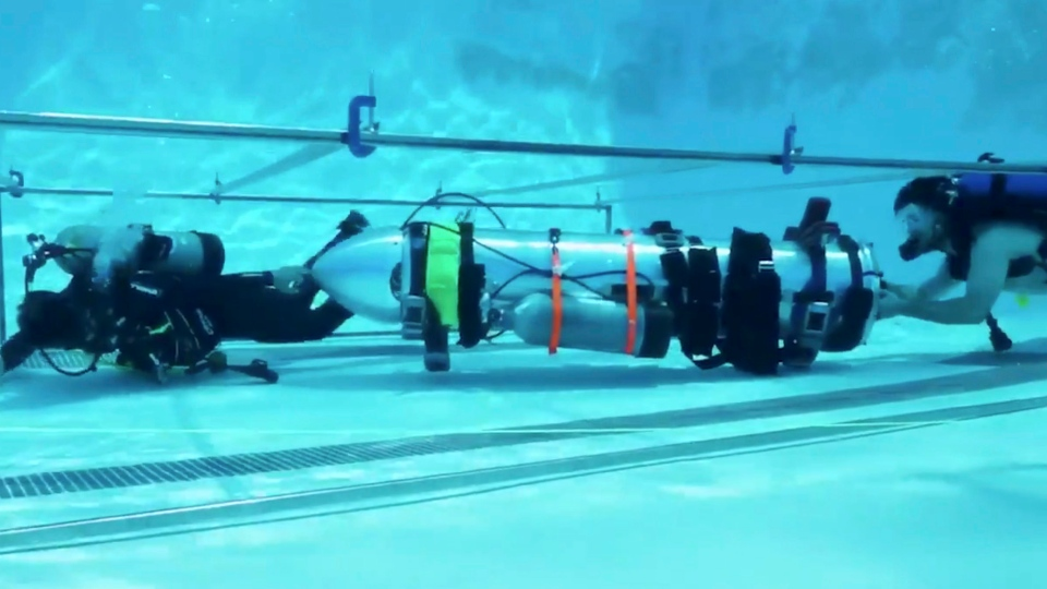 This frame grab from video tweeted by Elon Musk shows a 'tiny kid-sized submarine' being tested in a pool at Palisades Charter High School, on July 8, 2018. (Courtesy of Elon Musk via AP)