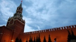 A guard patrols in front of the walls of the Kremlin at dusk in Red Square, during the 2018 soccer World Cup in Moscow, Russia, Saturday, June 30, 2018. (AP / Rebecca Blackwell)