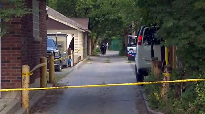 Toronto police comb through an area in The Annex where gunfire erupted late Monday night.