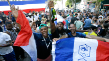 Supporters of France celebrate the victory of their team against Uruguay during their quarterfinal match at the 2018 soccer World Cup played in Russia, as they watch a live broadcast of the match in a bar, in Marseille, southern France on July 6, 2018. (AP Photo/Claude Paris, File)