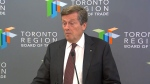 Mayor John Tory speaks with reporters at the Toronto Region Board of Trade on Tuesday.