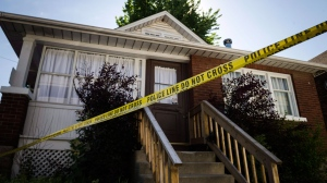 Police tape surrounds a home in Oshawa, Ont., on Tuesday, July 10, 2018. THE CANADIAN PRESS/Christopher Katsarov