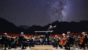 "The outdoor Edmonton Symphony Orchestra Strings perform during the ""Symphony Under the Stars"" show. (Tourism Jasper)"