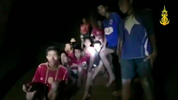 In this grab taken from video provided by the Thai Navy Seal, a view of the boys and their soccer coach as they are rescued in a cave, in Chiang Rai in Thailand, Monday, July 2, 2018. Rescuers found all 12 boys and their soccer coach alive deep inside a partially flooded cave in northern Thailand late Monday, more than a week after they disappeared and touched off a desperate search that drew international help and captivated the nation. (Thai Navy Seal via AP)