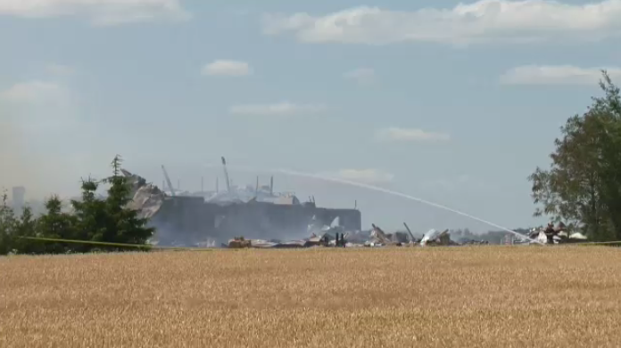 Two barns were completely destroyed by fire Tuesday afternoon.