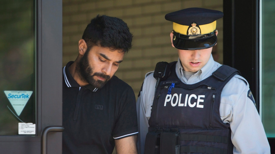 Truck driver Jaskirat Sidhu walks out of provincial court after appearing for charges due to the Humboldt Broncos bus crash in Melfort, Sask., on Tuesday, July 10, 2018. (THE CANADIAN PRESS/Kayle Neis)