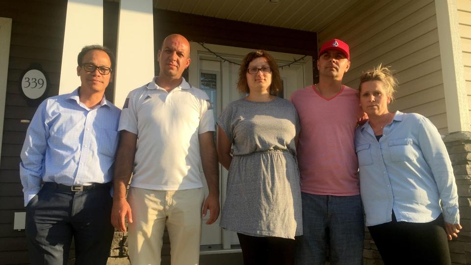 Kensington homeowners (from left to right) Francisco Balderama, Rishad Bismullah, Dragana Radenkobic, Alex Desiatnyk and Veronika Szabo claim their homes, built by Dream, are a nightmare. (Angelina Irinici/CTV Saskatoon)