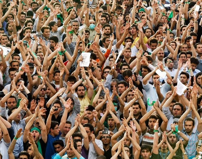 Hundreds of thousands of supporters of leading opposition presidential candidate Mir Hossein Mousavi, who claims there was voting fraud in Friday's election, turn out to protest the result of the election at a mass rally in Azadi (Freedom) square in Tehran, Iran, Monday, June 15, 2009. (AP / Ben Curtis)