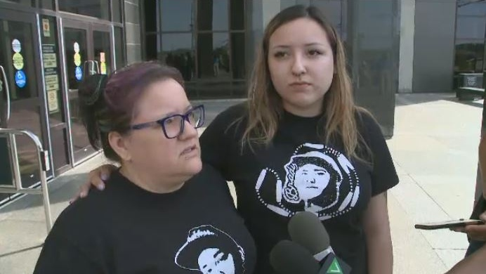 Jessica Perley and Sara Perley-Francis, the mother and sister of Brady Francis, attend a court appearance in Moncton on July 10, 2018.