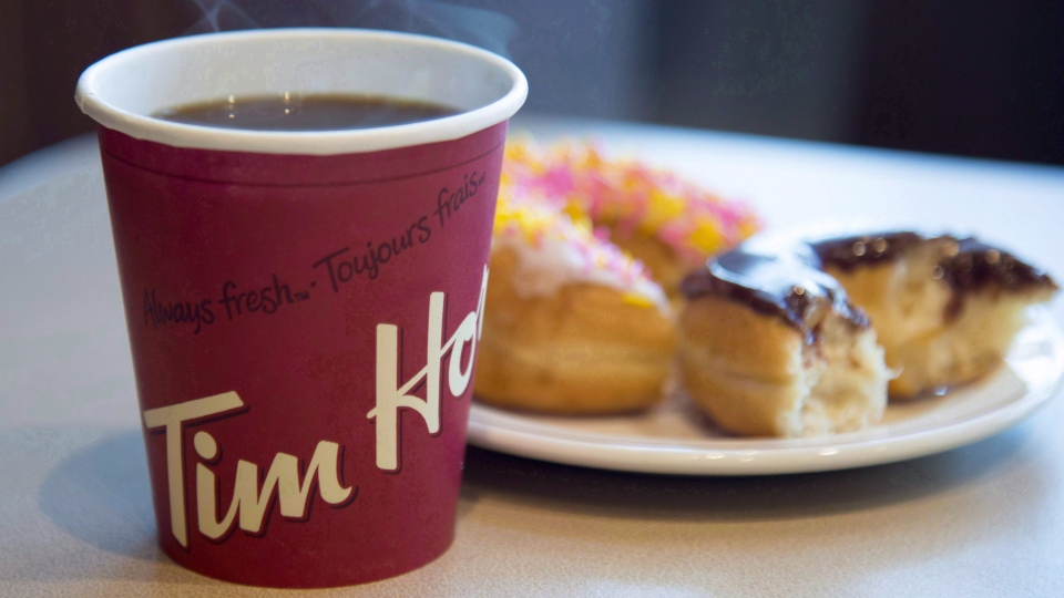 A coffee and donut from Tim Hortons is seen at a Coquitlam B.C., location on April 26, 2018. Tim Hortons has signed an exclusive master franchise joint venture agreement with Cartesian Capital Group to develop and open more than 1,500 Tim Hortons restaurants throughout China over the next 10 years. THE CANADIAN PRESS/Jonathan Hayward
