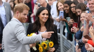 Prince Harry and Meghan, Duchess of Sussex, meet members of the public at Trinity college, Dublin, Ireland, Wednesday, July 11, 2018. (AP Photo/Peter Morrison)