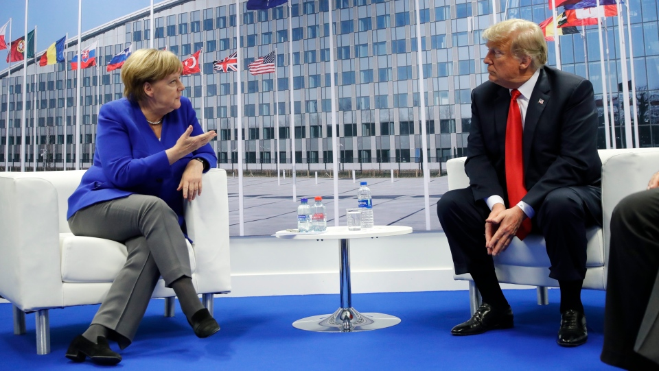 U.S. President Donald Trump meets with German Chancellor Angela Merkel during their bilateral meeting at the NATO Summit in Brussels, Belgium, Wednesday, July, 11, 2018. (AP Photo/Pablo Martinez Monsivais)