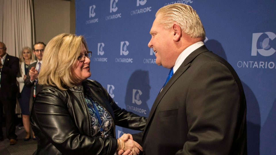 Doug Ford is congratulated by Lisa Thompson, Chair of the PC Ontario Caucus after Ford was named as the newly elected leader of the Ontario Progressive Conservatives at the delayed Ontario PC Leadership announcement in Markham, Ont., on Saturday, March 10, 2018. (THE CANADIAN PRESS/Chris Young)