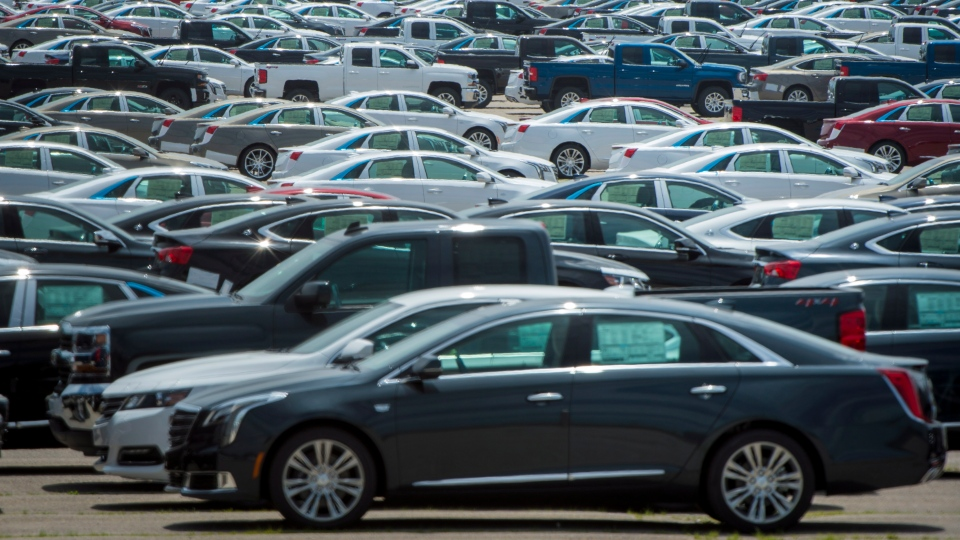 Vehicles are seen in a parking lot at the General Motors Oshawa Assembly Plant in Oshawa, Ont., on Wednesday, June 20, 2018. THE CANADIAN PRESS/ Tijana Martin