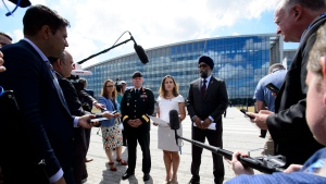 Chief of Defence Staff Jonathan Vance, left to right, Minister of Foreign Affairs Chrystia Freeland, and Minister of National Defence Minister Harjit Singh Sajjan talk to media at the NATO Summit in Brussels, Belgium on Wednesday, July 11, 2018. THE CANADIAN PRESS/Sean Kilpatrick