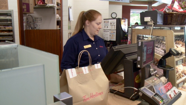 Tim Hortons employee prepares delivery.
