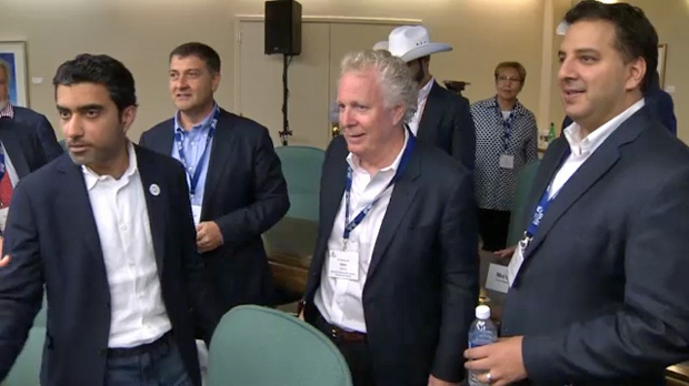 Delegates, including CUBC co-chair Jean Charest, at the July 11, 2018 investment symposium in Calgary
