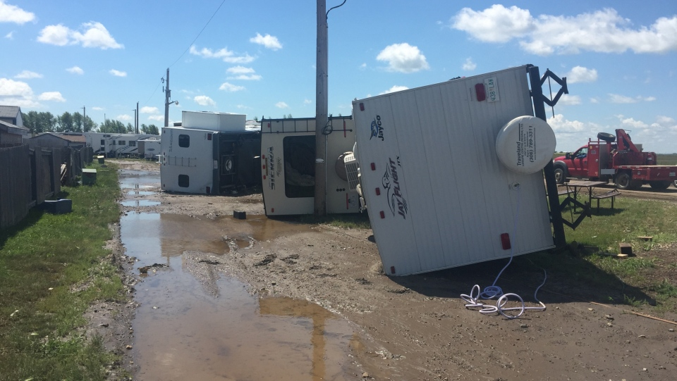 Four trailers sit flipped over on Wednesday, July 11, 2018, after a storm in Kindersley the previous day. (Laura Woodward/CTV Saskatoon)
