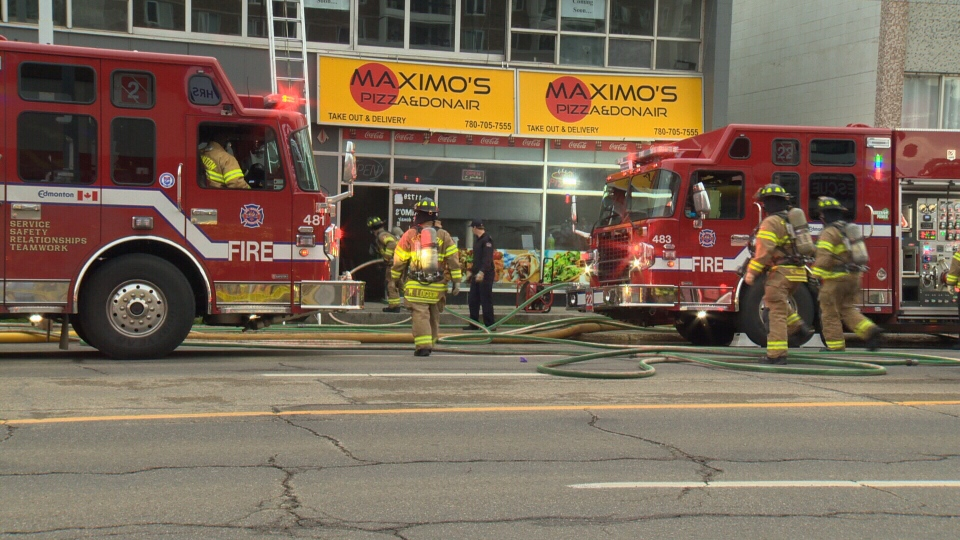 Nearly 50 firefighters responded to a blaze at this commercial building on Jasper Avenue on Wednesday, July 11, 2018.