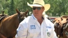 Tanner Milan was able to compete in the Calgary Stampede's steer wrestling event after another competitor lent him horses to replace the ones that were stopped at the U.S.-Canada border
