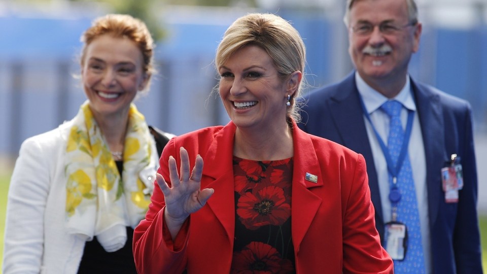 Croatian President Kalinda Grabar-Kitarovic waves at NATO headquarters in Brussels on July 11, 2018. (Francois Mori / AP)