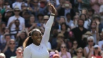 Serena Williams of the United States celebrates winning her women's singles quarterfinals match against Italy's Camila Giorgi, at the Wimbledon Tennis Championships, in London, Tuesday July 10, 2018.(AP Photo/Ben Curtis)