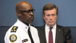 Toronto Police Chief Mark Saunders, left, stands beside Toronto Mayor John Tory during a news conference at police headquarters in Toronto on Tuesday, April 24, 2018. THE CANADIAN PRESS/Chris Young