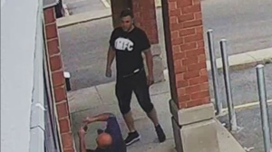 Laval police released security camera footage from a daycare in Laval in hopes of apprehending the perpetrator (pictured), who ran up to a man and punched him in the face - inflicting injuries bad enough to require surgery, police said. (Photo courtesy Laval Police)