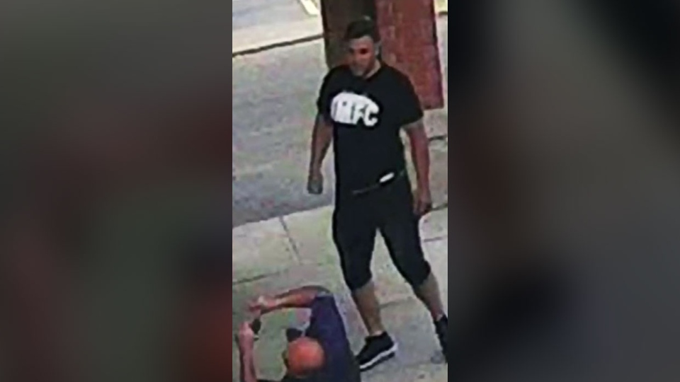 Police say they've made an arrest in a sucker-punch attack outside a Montreal-area daycare last month that was captured on surveillance video. (Laval Police)