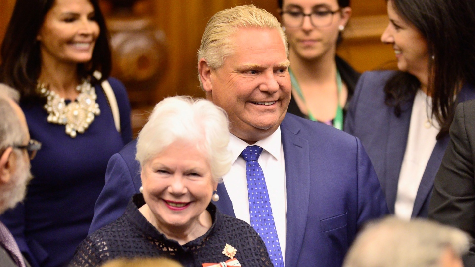 Ontario Premier Doug Ford, right, and Lt.-Gov. Elizabeth Dowdeswell arrive ahead of the speech from the throne to open the new legislative session at the Ontario Legislature at Queen's Park in Toronto on Thursday, June 12, 2018. (THE CANADIAN PRESS/Frank Gunn)