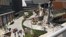The Artz Pedregal shopping mall stands partially collapsed, on the south side of Mexico City, Thursday, July 12, 2018. The mall collapsed after structural problems apparently led the mall's operators to stage a quick, controlled demolition. (AP Photo/Anthony Vazquez)