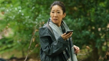 "This image released by BBC America shows Sandra Oh in a scene from ""Killing Eve."" Oh was nominated Thursday for an Emmy for outstanding lead actress in a drama series. (BBC America via AP)"