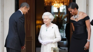 In this Wednesday, May 25, 2011 file photo, U.S. President Barack Obama and first lady Michelle Obama welcome Queen Elizabeth II for a reciprocal dinner at Winfield House in London. (AP / Charles Dharapak, File)