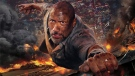 This image released by Universal Pictures shows Dwayne Johnson in a scene from 'Skyscraper.' (Universal Pictures via AP)