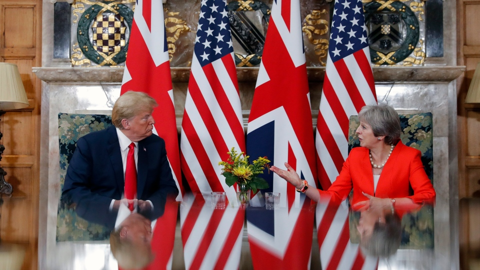 U.S. President Donald Trump with British Prime Minister Theresa May during their meeting at Chequers, in Buckinghamshire, England, Friday, July 13, 2018. (AP Photo/Pablo Martinez Monsivais)