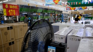 Chinese brand home appliances sit on display for sale at a hypermarket in Beijing, Wednesday, July 11, 2018.(AP Photo/Andy Wong)