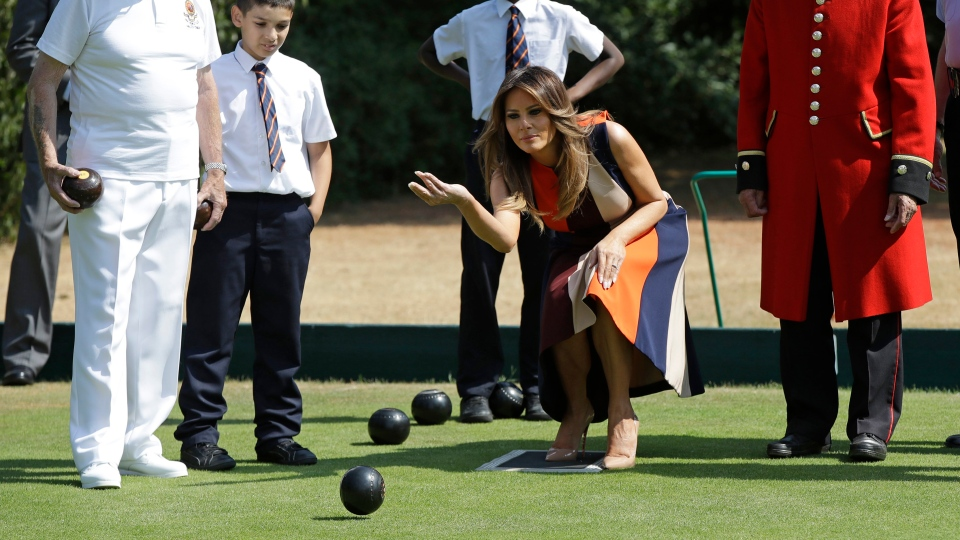 "U.S. First Lady Melania Trump plays bowls with British military veterans known as ""Chelsea Pensioners"" at The Royal Hospital Chelsea in central London Friday, July 13, 2018. (AP Photo/Luca Bruno, Pool)"