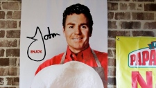 This Dec. 21, 2017, file photo shows signs, including one featuring Papa John's founder John Schnatter, at a Papa John's pizza store in Quincy, Mass. Papa John's plans to pull Schnatter's image from marketing materials after reports he used a racial slur. AP Photo/Charles Krupa, File)