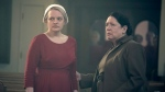 "This image released by Hulu shows Elisabeth Moss, left, and Ann Dowd in a scene from ""The Handmaid's Tale."" (George Kraychyk/Hulu via AP)"