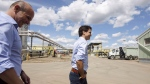 Prime Minister Justin Trudeau, right and Edmonton member of parliament, Randy Boissonnault visit Kinder Morgan terminal in Edmonton Alta, on Tuesday June 5, 2018. (Jason Franson/ The Canadian Press)