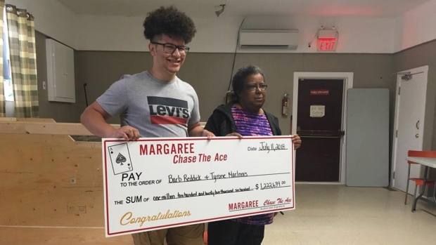 Tyrone MacInnis, left, and Barb Reddick, right, accept their Chase the Ace lottery prize in this undated handout photo. THE CANADIAN PRESS/HO, Bernice Curley, Chase The Ace Margaree