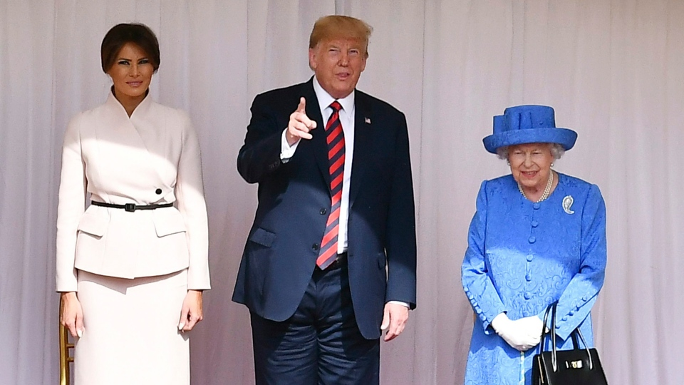 Queen Elizabeth II, right, stands with US President Donald Trump and first lady Melania on the dias in the Quadrangle during a ceremonial welcome at Windsor Castle, Friday, July 13, 2018 in Windsor, England. (Ben Stansall/Pool Photo via AP)